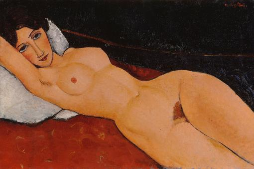 Lying female nude on white pillow